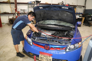 Technician working under the hood of a Honda at Horeb Auto Repair